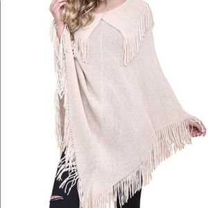 Beige and white fringed poncho